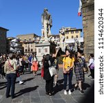 Small photo of Florence, Italy - September 30, 2017: Tourists admire the historical buildings and statues on the Piazza della Signoria in Florence, Italy on September 30, 2017