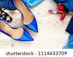 lacquered blue female shoes ... | Shutterstock . vector #1114633709