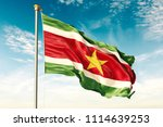suriname flag on the blue sky... | Shutterstock . vector #1114639253