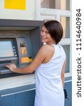 woman withdrawing money from... | Shutterstock . vector #1114640984