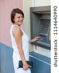 woman withdrawing money from... | Shutterstock . vector #1114640990