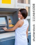 woman withdrawing money from... | Shutterstock . vector #1114641008