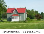 farmhouse with red roof | Shutterstock . vector #1114656743