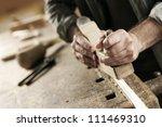 hands of a carpenter planed... | Shutterstock . vector #111469310