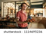 portrait of a young waiter...   Shutterstock . vector #1114695236
