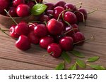 red cherries on rustic wood | Shutterstock . vector #1114722440