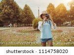 smiling black tourist girl in... | Shutterstock . vector #1114758020