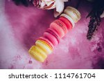 row of cake macaroons on bright ... | Shutterstock . vector #1114761704