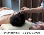 therapist giving acupuncture... | Shutterstock . vector #1114796906