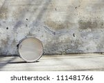Drum In Front Of A Wall