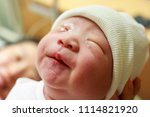 mother giving birth to a baby.... | Shutterstock . vector #1114821920