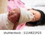 Small photo of Mother giving birth to a baby. Female pregnant patient in a modern hospital.
