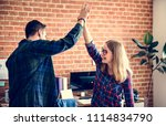 caucasian colleagues give each... | Shutterstock . vector #1114834790