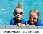 happy children in wetsuits and... | Shutterstock . vector #1114843106