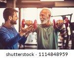 fitness instructor helping... | Shutterstock . vector #1114848959