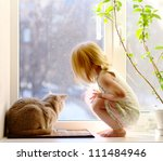 Cat And Girl Looking Out Of Th...