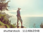 hike in na pali coast in kauai... | Shutterstock . vector #1114863548