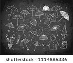 set of doodle sketch umbrellas... | Shutterstock .eps vector #1114886336