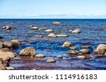 rocky beach in the baltic sea... | Shutterstock . vector #1114916183