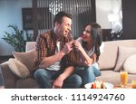 excited loving couple is... | Shutterstock . vector #1114924760