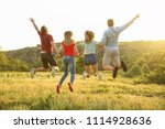 happy young people jumping in... | Shutterstock . vector #1114928636
