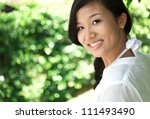 young woman smiling at camera... | Shutterstock . vector #111493490