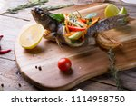 grilled dorado fish stuffed... | Shutterstock . vector #1114958750