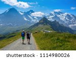 a group of tourists with the... | Shutterstock . vector #1114980026