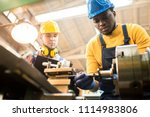 serious concentrated african... | Shutterstock . vector #1114983806