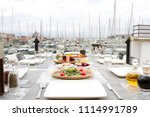 restaurant at sea shore against ... | Shutterstock . vector #1114991789