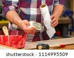 carpenter doing his job in... | Shutterstock . vector #1114995509