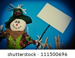 Scarecrow Holding A Sign
