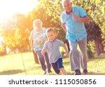 grandparents with grandson... | Shutterstock . vector #1115050856