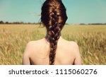girl with naked back standing...   Shutterstock . vector #1115060276