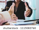close up shake hands lawyers in ...   Shutterstock . vector #1115083760