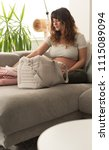 pregnant woman packing... | Shutterstock . vector #1115089094