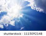 sunbeams and clouds. | Shutterstock . vector #1115092148