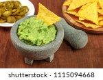 a photo of guacamole sauce in a ... | Shutterstock . vector #1115094668