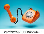 Old orange telephone rings with ...