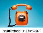 old orange telephone rings with ... | Shutterstock . vector #1115099339