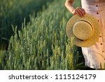 Girl Holding Straw Hat  Copy...