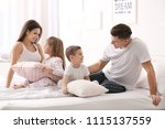 happy family on bed with soft... | Shutterstock . vector #1115137559