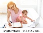 mother with baby working and... | Shutterstock . vector #1115159438