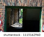 the entrance to destroyed house ... | Shutterstock . vector #1115162960