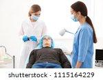professional beautician... | Shutterstock . vector #1115164229