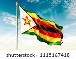 zimbabwe flag on the blue sky... | Shutterstock . vector #1115167418