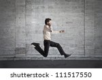 young businessman running fast... | Shutterstock . vector #111517550