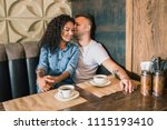 happy young couple is drinking... | Shutterstock . vector #1115193410