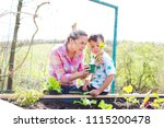 beautiful mother and her blond... | Shutterstock . vector #1115200478
