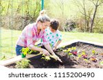 beautiful mother and her blond... | Shutterstock . vector #1115200490